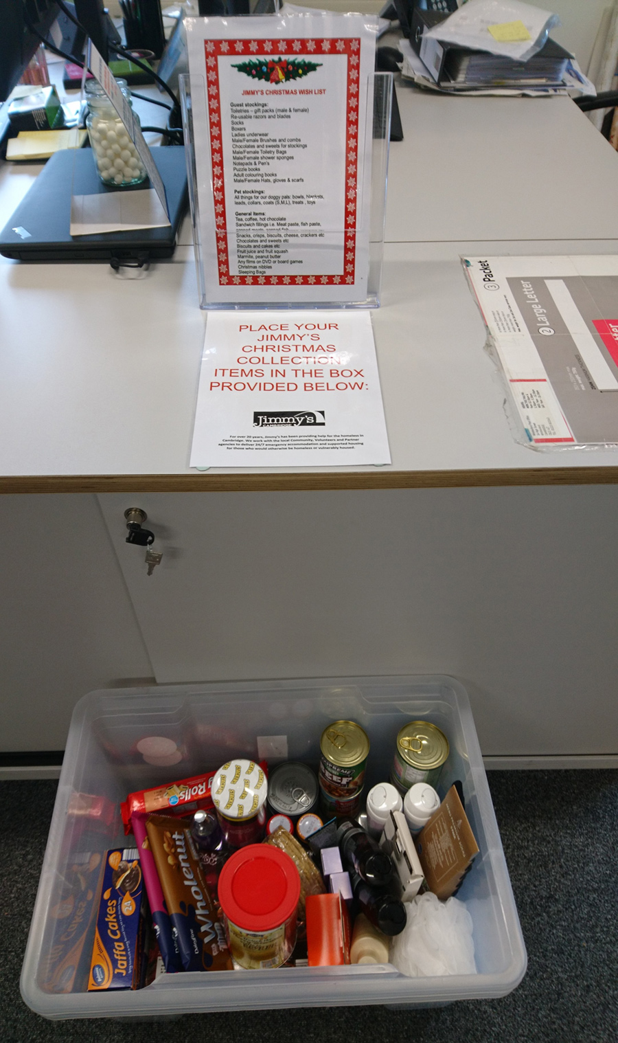 The collection box in an office for the Jimmy's Cambridge charity